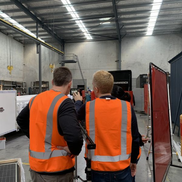 OYO Studios, BRAND AND DESIGN SPECIALIST, Wayne Froneman on a video shoot in a large warehouse with Dan Stevenson from Bordertown Films for client, OMNEXA in Brisbane Queensland Australia